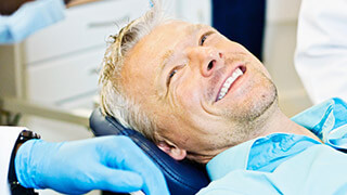 Relaxed man smiling in dental chair