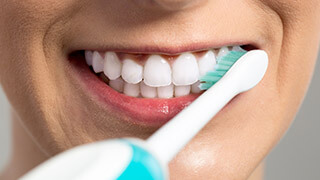 Closeup of smile during teeth brushing
