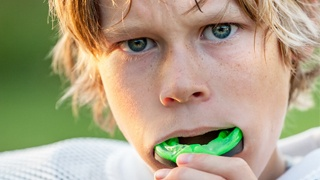 young football player with mouthguard
