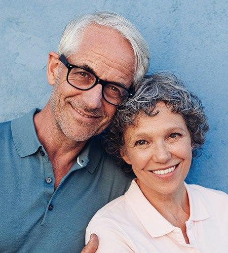 Older couple with healthy happy smiles
