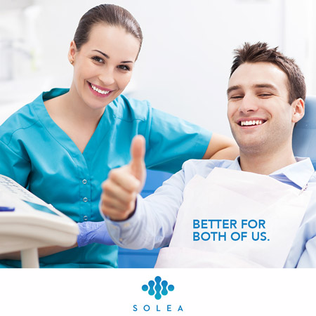 patient smiling with dentist