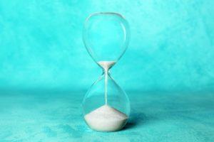 Sand in hourglass to illustrate deadline for 2020 dental insurance