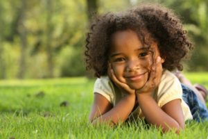 young girl smiling curly hair