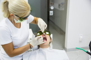 Patient receiving laser dentistry services